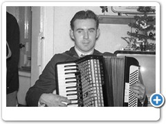 Billy MacDougall playing accordian
