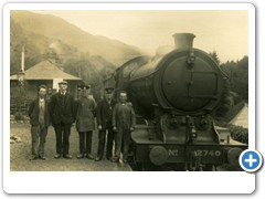 Group beside railway engine at Station